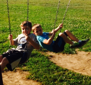 Boys on swing